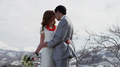 Time lapse medium shot of bride and groom kissing outdoors / Utah, United Stock Footage