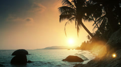 Sunset on paradise beach with beautiful lens flare Stock Footage