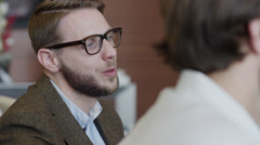 Close up shot of bearded businessman talking to co-workers / Provo, Utah, United Stock Footage