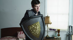 MS Man wearing armor playing with sword / Orem,Utah,USA - stock footage