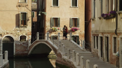 WS Couple on footbridge over canal / Venice,Italy Stock Footage