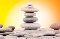 Pebbles stack against gradient background Stock Photos