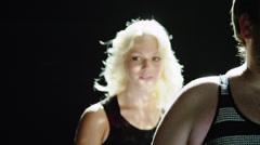CU PAN Studio shot of man dancing,women in background Stock Footage