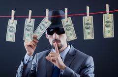 Criminal laundering dirty money - stock photo