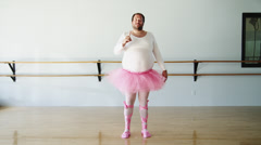 WS Overweight man wearing ballerina costume practicing in ballet studio / Stock Footage