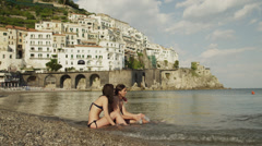 WS Young couple relaxing on Amalfi Beach / Italy Stock Footage