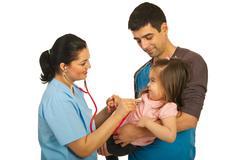 Doctor examine toddler girl - stock photo