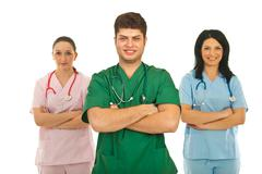 Cheerful team of three doctors Stock Photos