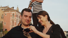 CU Couple talking and embracing traveling in gondola / Venice,Veneto,Italy Stock Footage