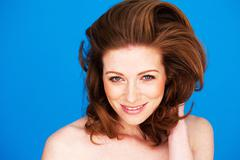 Smiling Woman With Auburn Hair - stock photo
