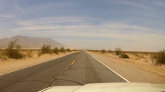Driving Old Highway In Barren And Dusty Mojave Desert- Surreal Stock Footage