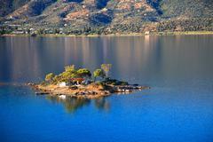 Small island in Aegean sea - stock photo