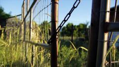 Panning shot of a farm gate Stock Footage