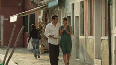 WS Couple walking along canal / Murano,Venice,Italy Stock Footage
