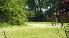 US infantry patrols during the reenactment of Normandy 21 Stock Footage