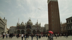 WS TU Tourists in front of St. Mark's Cathedral and campanile / Venice,Italy Stock Footage