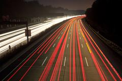 Night time traffic on highway - stock photo