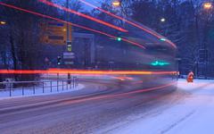 Street traffic in snowstorm - stock photo
