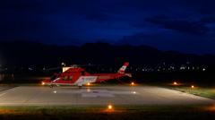 4k life flight on heli pad at night. Stock Footage