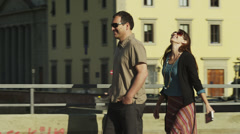 MS PAN Man giving woman piggy back ride across bridge,Ponte Vecchio in Stock Footage