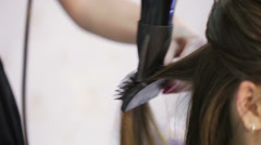 Laying hairstyles hairdryer - stock footage