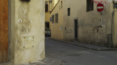 WS Woman walking through old town streets/ Florence,Tuscany,Italy Stock Footage