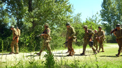 US infantry patrols during the reenactment of Normandy Stock Footage
