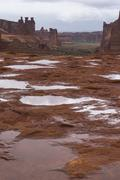 Puddles of water after rainstorm in the arches national park Stock Photos
