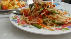 Freshly mixed Som Tam, a POPULAR Thailand green papaya salad Stock Footage