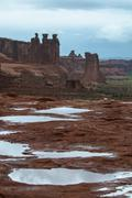 puddles of water after rainstorm in the arches national park - stock photo