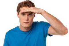 Man observing something closely - stock photo