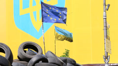 Ukrainian and European flag on the barricades of tires in Kiev on euromaidan Stock Footage