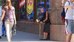 Homeless woman begging on the sidewalk near Independence Square in Kiev, Ukraine Stock Footage