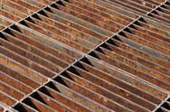 Stock Photo of Rusty sewer grate