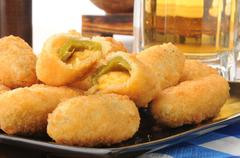 Jalapeno cheese sticks and beer Stock Photos