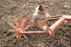 Old garden cultivator - stock photo