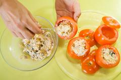 Cook stuffing tomato salad Stock Photos