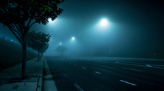 4K. Street intersection traffic foggy night Los Angeles, California. Timelapse. Stock Footage