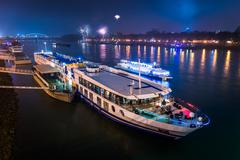 Passenger boat with fireworks in background Stock Photos