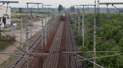 Stock Video Footage of Passenger train crossing, commuters train, railway, overhead shot