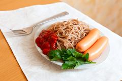Spaghetti pasta with sausages Stock Photos