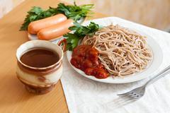 Spaghetti pasta and sausages Stock Photos