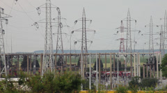 Electricity power station, line of electrical transmission towers carrying high Stock Footage