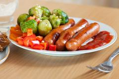 Sausages and broccoli with vegetables Stock Photos