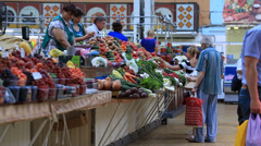 People buying and selling vegetables and fruit at market. Kiev, Ukraine Stock Footage