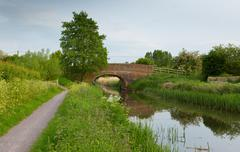 English country scene with bridge over a river - stock photo