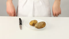 Female cook peeling potatoes Stock Footage