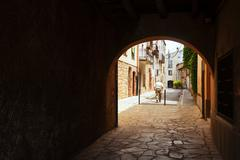 Old street with archway in the European town Stock Photos