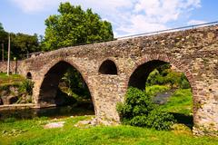 Medieval bridge in Sant Joan les Fonts - stock photo