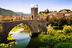 Medieval bridge with antique gate - stock photo